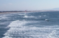 Kiteboarder mocks the bobbing surfers